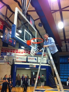 Coach Cliff McDaniel cuts down the net after defeating Rhema Bible College 85-67 for the ACCA National Title